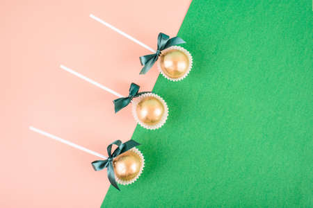 Delicious and beautiful cake pops on an abstract background. Delicious dessert for St. Patrick's Day