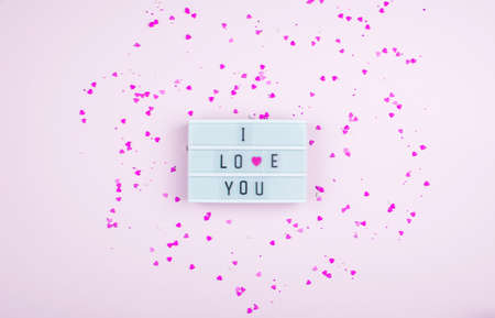Words i love you on the light box on a light background. Place for text, abstract content. Valentines day