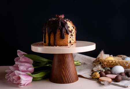 Delicious and very beautiful Easter cake with chocolate and nuts on a beautiful stand. Festive contin.