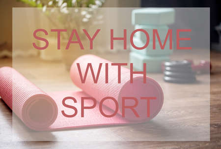 Home workouts at home using a mat, dumbbell, stretch marks. Home online fitness.