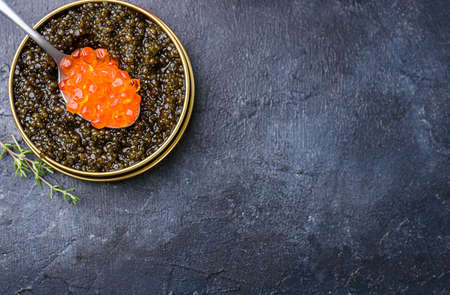 Fresh red and black caviar, seafood, dark background, top view. Good food. Delicious food content Banque d'images