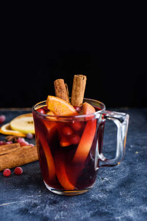 Mulled red wine with spices. Christmas decoration. Grey background. Copy space. New years content