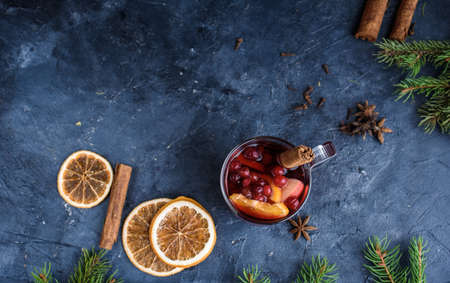 Still life, food and drink, seasonal and holidays concept. Christmas mulled wine on a rustic wooden table. Selective focus, copy space background