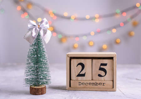 New Years content, Christmas tree gold toys, a small Christmas tree, lights, wood eco cubes with the figure on December 25.