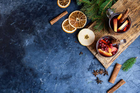 Christmas mulled wine. Holiday concept decorated with Fir branches, Cranberries and Spices.