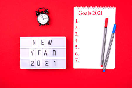New Year Resolution Goal List 2021 - notebook written in handwriting about plan listing of new year goals and resolutions setting.