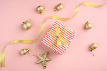New Years content with sprigs ate, gold toys for the Christmas tree. gift decorated with gold ribbon, the symbol of the new year 2021. Standard-Bild