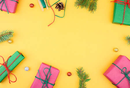 Christmas composition. Christmas gifts, pine branches, toys on white background. Flat lay, top view. Standard-Bild