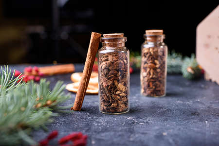 New Years set for mulled wine in a wood box. Fragrant spices, orange peel, cinnamon sticks, badyan.