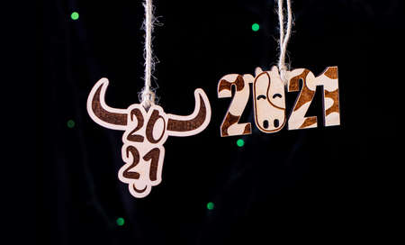 Symbol of the new year. A year of the bull. Wooden toys on Christmas trees in the form of beautiful bulls.