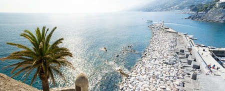 The manmade pier of the sea touristic village of Camogli, Liguria, Italy that faces the wonderful Paradise bay in the Mediterranean sea