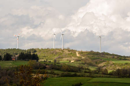 Landscape view of the Monte Galletto wind farm in Bologna Italy. this hill is crossed by the path of the