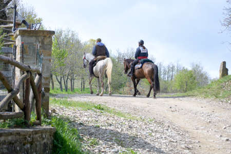 Gods way between two men on horseback on a hiking path between Bologna and Florence