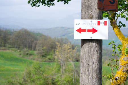 Direction sign on the Via dei Dei or The Gods way in the Apennines mountains in Italy, between Bologna and Florence