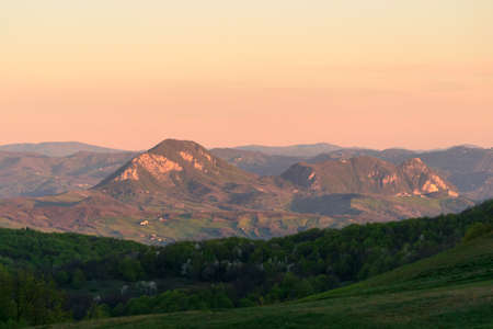 Apennines mountain landscape seen from the Bone Plain at sunrise time in the morning, in a wide valley near Firenzuola, on the path of the Gods road or the way of the Gods