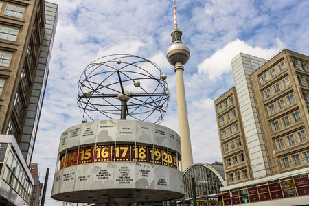 BERLIN, GERMANY - JUNE 16, 2018: Urania World Clock on public square of Alexanderplatz with Fernsehturm televison tower in Berlin, Germany. Editorial