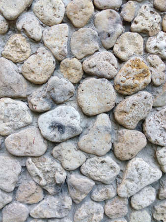 yellow stone: Wall of a mosaic of yellow stone sea