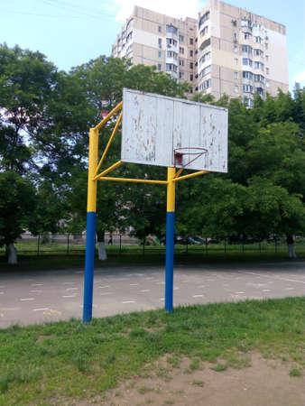 school yard: White wooden basket ball in the school yard