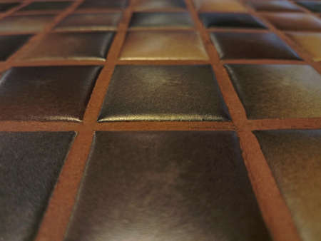 perspective texture of ceramic brown mosaic tiles