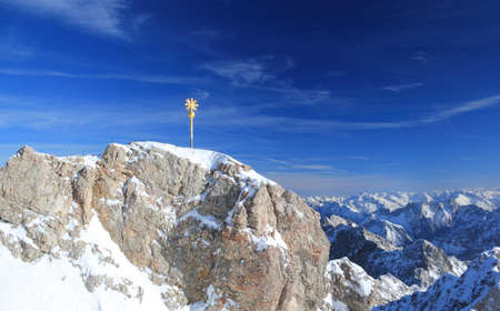 Zugspitze mountain - Top of Germany. The Zugspitze, at 2,962 meters above sea level, is the highest mountain in Germany. Stock fotó - 90500485