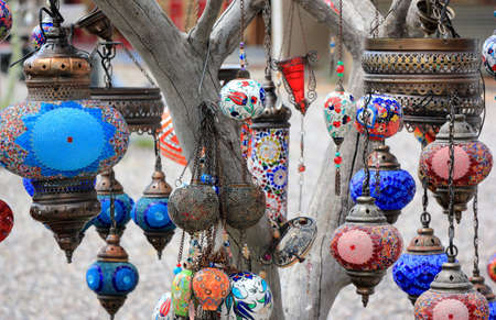 Oriental lamps on the branches of a tree. Close-up. Cappadocia, Central Anatolia, Turkey.