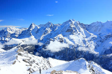 View of Eiger, Mönch and Jungfrau from Schilthorn. Bernese Alps of Switzerland, Europe.