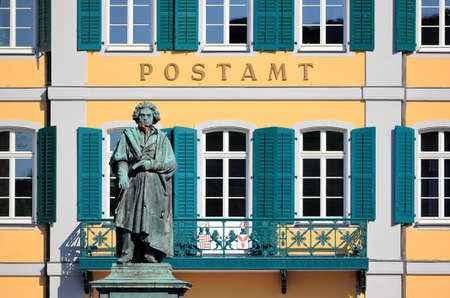 Monument of Ludwig van Beethoven - with the Old Post Office building in the background. Bonn, Germany. Editorial