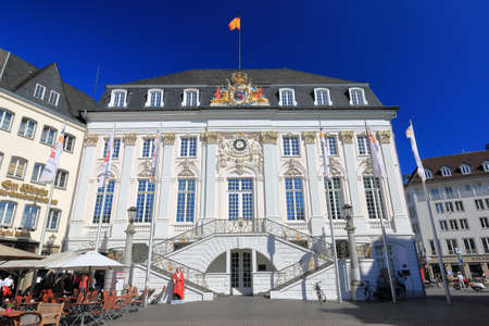 Bonn, Germany – June 11, 2020: Old town hall with unidentified people on a sunny evening in June. It was built in Rococo-style by the court architect M. Leveilly in 1737 - 1738. Editorial