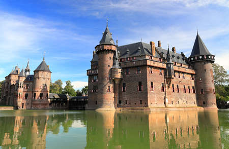 Utrecht, The Netherlands - September 7, 2020: Visiting de Haar Castle and the beautiful park on a sunny morning in September. De Haar is one of the most well-known medieval castles in the Netherlands.
