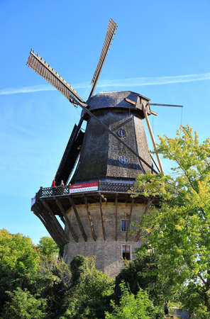 Potsdam, Germany - September 18, 2020: Visiting the royal palace und park Sanssouci in Potsdam on a sunny day in September. View on the historic windmill.