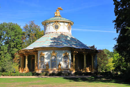 Potsdam, Germany - September 18, 2020: Visiting the royal palace und park Sanssouci in Potsdam on a sunny day in September. View on the Chinese House.