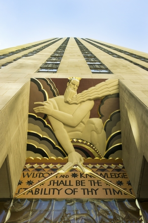 thy: New York City, United States - September 15, 2012: Rockefeller Center entrance featuring The Art Deco sculpture Wisdom and knowledge shall be the stability of thy times by Lee Lawrie. Stock Photo