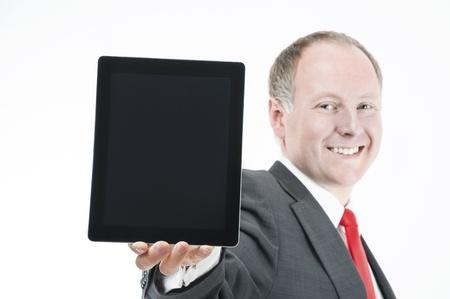 Smiling businessman holding digital tablet  photo