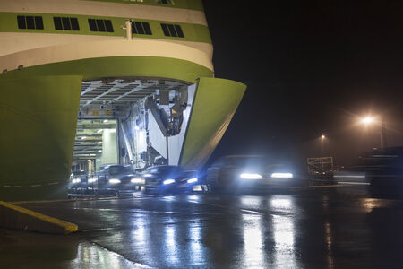 Unloading cars from big, green ferry