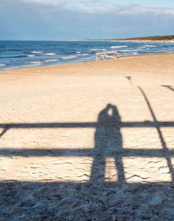 Shadow of a hugging couple on a beach photo