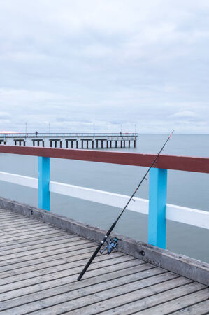 Fishing rod on The Baltic Sea jetty photo
