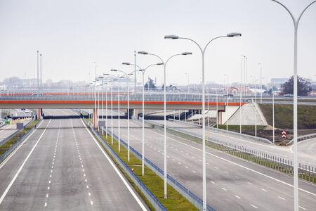 Brand new, wide motorway with street lamps alongside