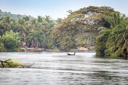 Traditional Boats on Tropical River Volta in Ghana, West Africa.