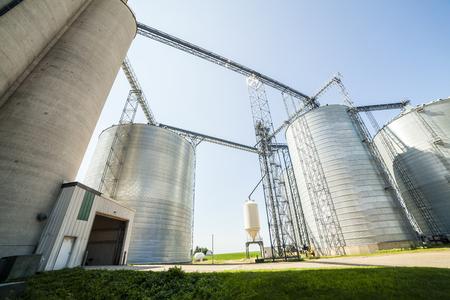 Huge silver shiny agricultural silos. Stok Fotoğraf - 31444867