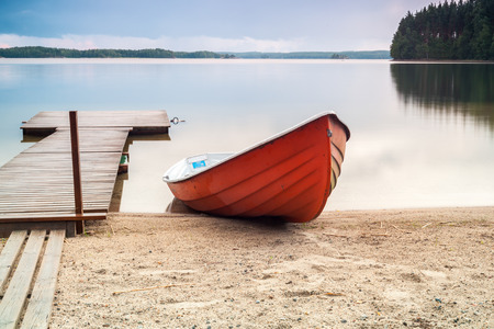 wooden boat: A boat and a pier in Finland Stock Photo