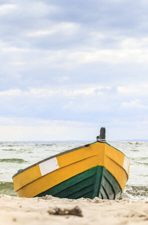 Wooden boat on The Baltic shore, Hel Peninsula. photo