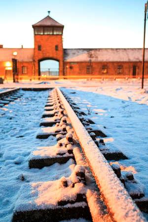 tortured: Main gate to concentration camp of Auschwitz Birkenau, Poland