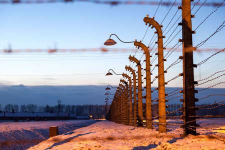 tortured: Fence around nazi concentration camp of Auschwitz Birkenau, Poland Editorial
