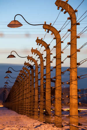 birkenau: Fence around nazi concentration camp of Auschwitz Birkenau, Poland Editorial