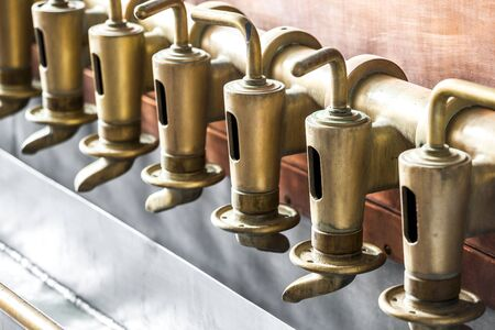 Copper tap in beer brewery building