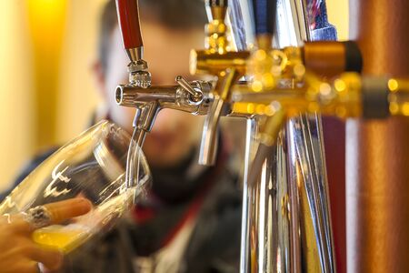 pouring beer: Pouring beer to a glass in a restaurant