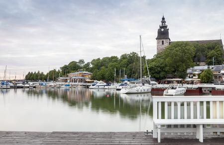 turku: Pretty harbor and historic church in Naantali close to Turku, Finland