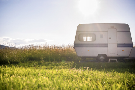 green park: Caravan trailer on a rural sunny setting
