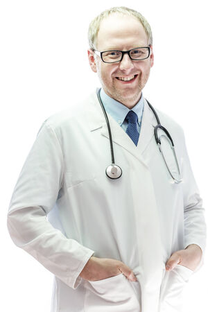 practitioner: Happy healthcare practitioner standing against white background Stock Photo