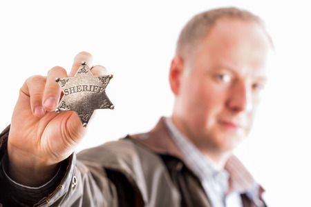 lawman: Sheriff presents his sheriff star badge isolated on white Stock Photo